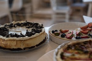 Close up of cake and tarts on table