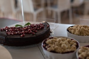 Close up of cake by food in containers on table