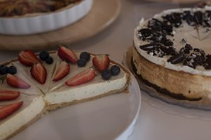 Close up of tart and cake on table