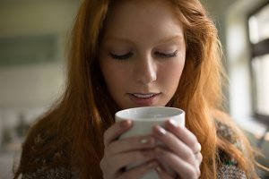 Close up of woman having coffee