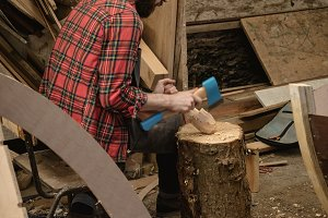 Carpenter making wooden spoon