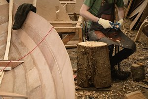 Low section of carpenter shaping wood
