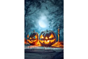 Halloween pumpkins on blue background