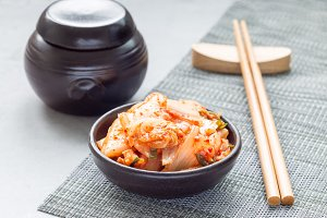 Kimchi cabbage. Korean appetizer in ceramic bowl, horizontal