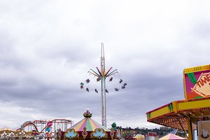 Low angle view of amusement park rides