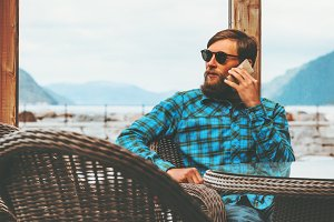 Bearded Man talking by smartphone