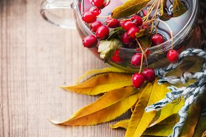Healthy autumn tea in glass cup