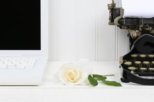 Rose on Desk Between Laptop and Type