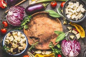 Vegetables ingredients around plate