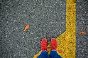 Man feet in red sneakers
