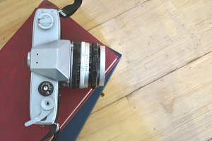 Vintage Camera, Books on wooden tabl
