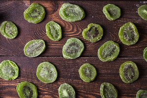 Dried kiwi on wooden background