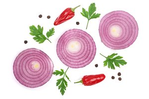 Sliced red onion rings with parsley leaves, hot pepper and peppercorns isolated on white background. Top view