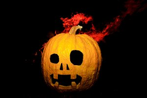 pumpkin head made with hands and flame