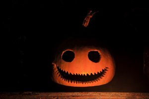 pumpkin head with a terrible smile in the dark