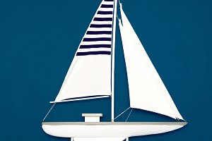 White yacht on a blue background.