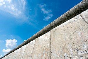 Top of Berlin Wall against blue sky
