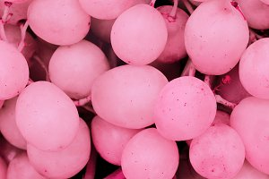 Background pink grapes.
