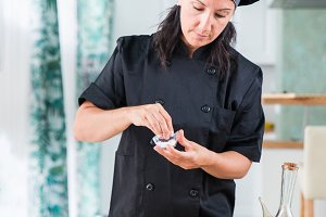 woman chef seasoning a dish