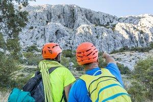 Climbers pointing away