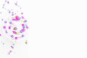 Vanilla cupcake with sprinkles purpl