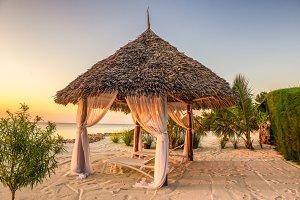 Beach lounge chairs at sunset, Zanzibar, Tanzania
