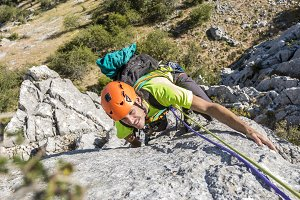 Backpacker climbing on mountain