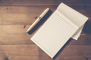 blank notebook with pen