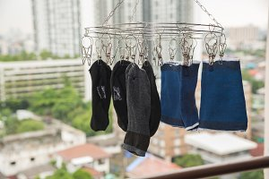 many socks drying on clothesline