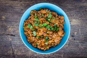 Lentil stew in a bowl with parsley