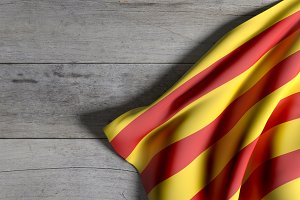 Catalonia flag on wooden surface