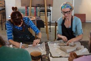 Female craftsperson practicing in art studio