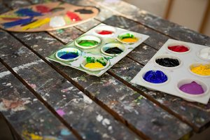 Close-up of colorful palettes on wooden table
