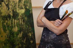 Confident woman looking at her painting