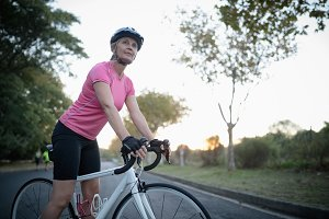 Woman riding bike on street
