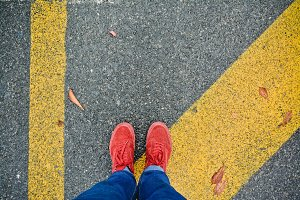 Red Shoes on Dark Road