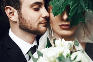 Wedding couple under green leaf
