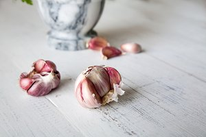 Garlic with marble mortar with parsl