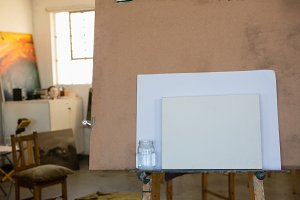 Artists canvas and paper on easel