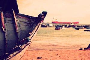 vintage boat on sand