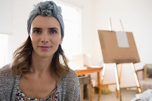 Close up of female artist wearing headband