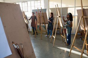 Adult students painting