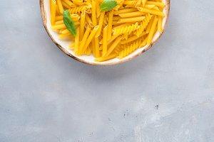 Italian raw short pasta in a dish