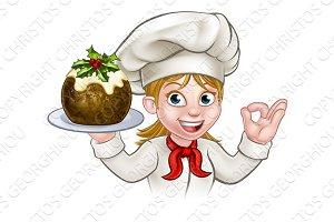 Woman Chef Holding Christmas Pudding