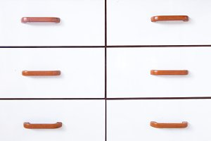 Drawers with wooden handles.