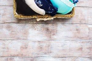 Woman bras in basket on wooden background