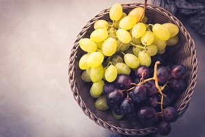 White and dark grapes in a basket
