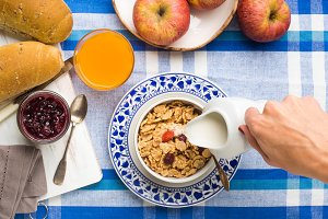 Home breakfast with cereals, milk, fruit and bread