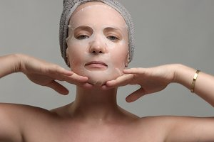 woman with a facial sheet mask on
