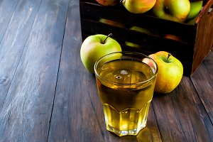 Glass of apple juice and apples